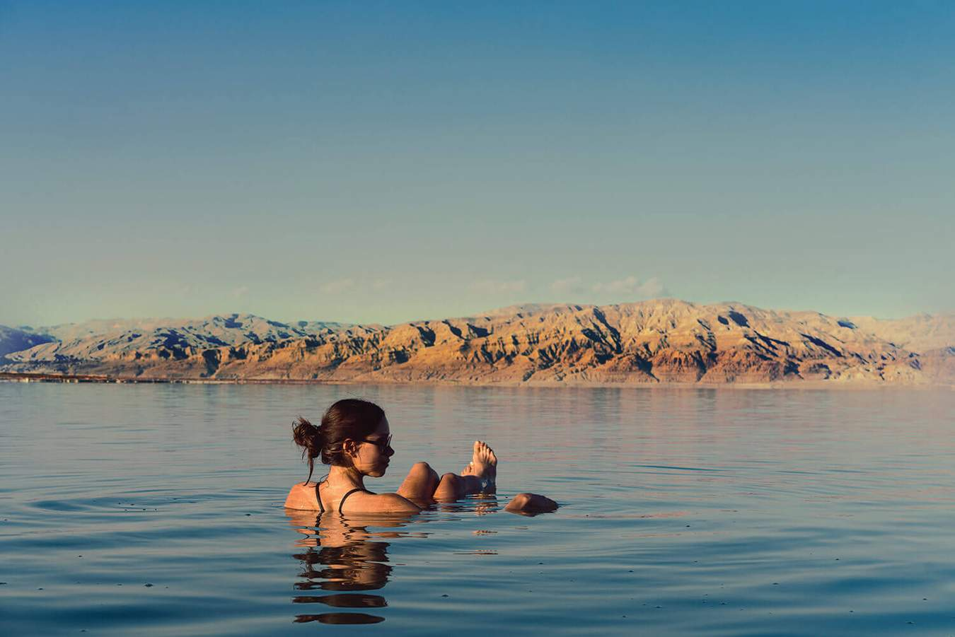 Woman Relaxing In Dead Sea